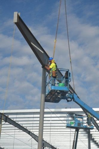 Man In Lift Setting Steel